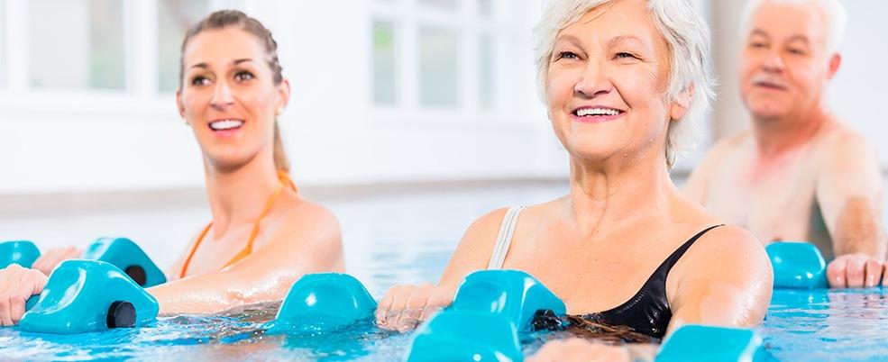 People in a pool doing water aerobics